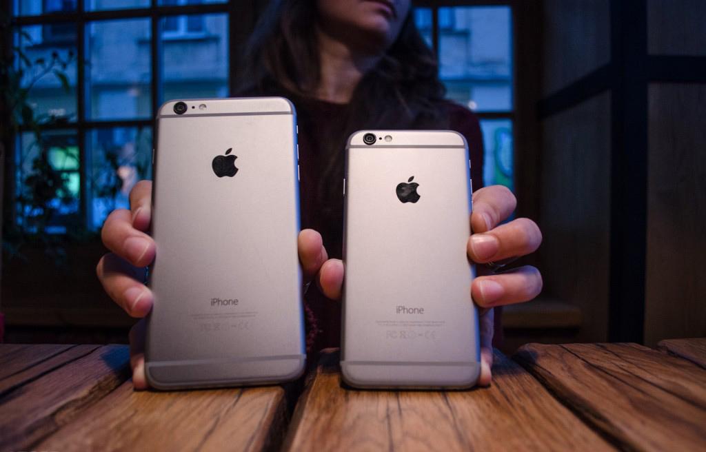 айфон 6s плюс в руке фото